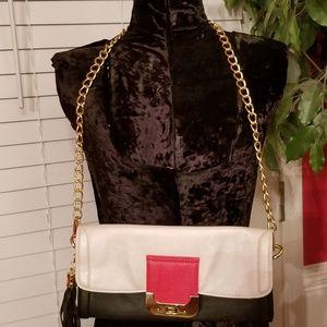 Cache clutch/handbag